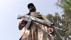 Pakistani Military Ranger standing Guard at an Islamist Rally in Karachi Stock Footage