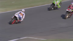 Motorcycles compete on a circuit track. Stock Footage