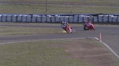 Motorcyclists race around a track. Stock Footage