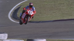 A motorcycle races around a track. Stock Footage