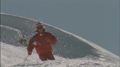 A man skies down a slope. Stock Footage