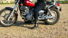 Rider Starts Motorcycle, Spins Out On Gravel Stock Footage