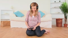 Blond-haired woman relaxing listening to music Stock Footage