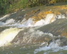 Loop of Creek Waters Rushing Over Rocks - PAL Stock Footage