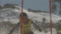 A skier navigates a down hill slalom course. Stock Footage