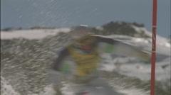 A skier swiftly around a slalom. Stock Footage
