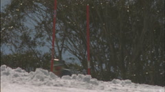 Alpine skier running a downhill course. Stock Footage