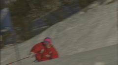 A skier navigates down hill through a slalom course. Stock Footage