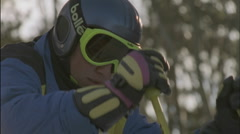 A skier prepares to take off down a slope. Stock Footage