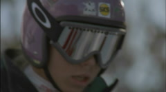 A young skier turns and begins to ski. Stock Footage