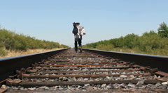 Hobo Walks On Railroad Tracks - stock footage