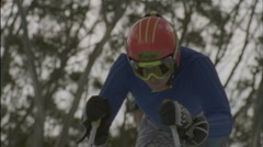 A skier starts to ski downhill. Stock Footage