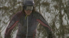 A skier launches himself forward from the starting line. Stock Footage
