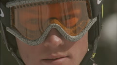 A child looks through goggles in a ski helmet. Stock Footage