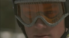 A skier takes a look around before descending  a slope. Stock Footage