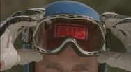 A skier adjusts his goggles. Stock Footage