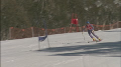 A skier reaches the finish line, as people watch. Stock Footage