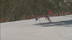A skier skis downhill as spectators watch. Stock Footage