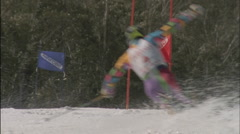 A skier skis down a mountain around colored flags. Stock Footage