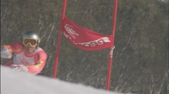 A man skies around a slalom pole. - stock footage