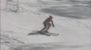 A skier skis down the hill, hitting the flag at the bottom. Stock Footage