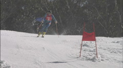 A skier skis downhill, hitting two flags. Stock Footage