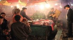 Uyghur food stand in Kashgar night market 3 Stock Footage