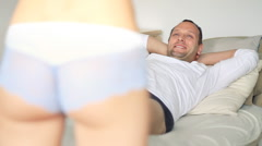 Sexy female ass trying to seduce man in bed HD Stock Footage