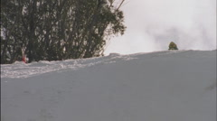 Stock Video Footage of A skier races down a slope.