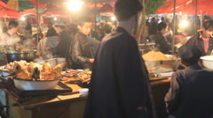 Uyghur food stand in Kashgar night market 1 - stock footage