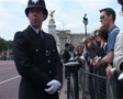 Policeman and Crowds at Buckingham Palace, London England Footage