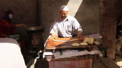 Uyghur Donut stand in Kashgar 2 Stock Footage