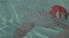 Swimmer competes in butterfly style in a swimming pool. Stock Footage