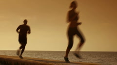 People doing sport activities near the sea Stock Footage