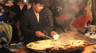 Stock Video Footage of Uyghur food stand in Kashgar night market 4