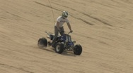 Riding Quad down the Dunes Stock Footage