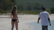 Stock Video Footage of HD720p25 Happy young couple playing on the beach. Slow Motion