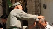 Uyghur Barber in Kashgar 2 Stock Footage