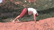 Man Doing Yoga Pose Downward Dog Stock Footage