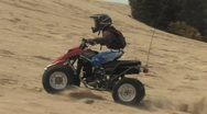 Kids Racing Quad Up the Hill Stock Footage