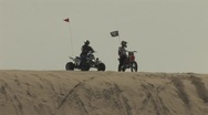 Bike and Quad on Top of Sand Dune Stock Footage