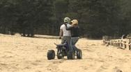 Husband & Wife Riding ATV Stock Footage
