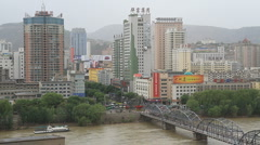 View of downtown Lanzhou and the Yellow River from White Pagoda Hill Stock Footage