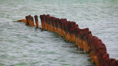 Stock Video Footage of rusty remnants of destroyed pier