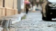 Stock Video Footage of car driving on rainy cobblestones street