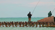 Stock Video Footage of Two fishermen on rusty pier