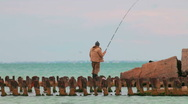 Stock Video Footage of fisherman on old destroyed pier