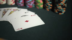 Full House - Aces Full of Kings - Poker Hand with Stacks of Chips at Casino - stock footage