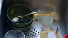 Dirty dishes in kitchen sink - stock footage