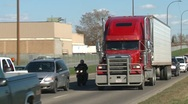 Trucking, semi red truck through frame Stock Footage